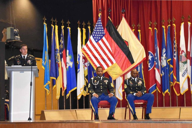 ANSBACH, Germany -- Thirteen NCOs from Installation Management Command -- Europe (IMCOM-E) participated in an induction ceremony at the Ansbach Theater on Bismarck Kaserene this afternoon, Sept. 14.The time-honored ceremony which marks each participant's transition into the Non-Commissioned Officers Corps was hosted by U.S. Army Garrison Ansbach (USAG Ansbach) Command Sgt. Major Philson Tavernier and attended by Command Sgt. Majors representing every Garrison in Europe and IMCOM Euorpe Headquarters: Command Sgt. Maj. Bryant Mason (USAG Italy), Command Sgt. Maj. Michael Sutterfield (USAG Bavaria), Command Sgt. Maj. Chad Pinkston (USAG Wiesbaden), Command Sgt. Maj. Samara Pitre (USAG Benelux), Command Sgt. Maj. Brett Waterhouse (USAG Rheinland Pfalz), Command Sgt. Maj. Toese Tia (USAG Stuttgart) and IMCOM--E Command Sgt. Major Ulysses Rayford, who had assembled in Ansbach for their annual Senior NCO Seminar.The thirteen Soldiers who proceeded through the NCO arches (pictured in random order): Sgt. Trayvon Johnson, Sgt. Orlando Lambert, Sgt. Jarod Phillips, Sgt Kiana Mitchell, Sgt. Tyler Shicks, Sgt. Jacob Doughty, Sgt. Leon Mendozamiranda, Sgt Scarlett Mitchell, Sgt. Chase Sykes, Sgt. Jose Heredia, Sgt. Krystal Lopez and Sgt. John Seely.