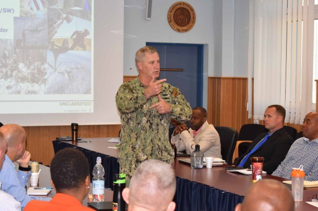 ANSBACH, Germany -- Thirteen NCOs from Installation Management Command -- Europe (IMCOM-E) participated in an induction ceremony at the Ansbach Theater on Bismarck Kaserene this afternoon, Sept. 14.The time-honored ceremony which marks each participant's transition into the Non-Commissioned Officers Corps was hosted by U.S. Army Garrison Ansbach (USAG Ansbach) Command Sgt. Major Philson Tavernier and attended by Command Sgt. Majors representing every Garrison in Europe and IMCOM Euorpe Headquarters: Command Sgt. Maj. Bryant Mason (USAG Italy), Command Sgt. Maj. Michael Sutterfield (USAG Bavaria), Command Sgt. Maj. Chad Pinkston (USAG Wiesbaden), Command Sgt. Maj. Samara Pitre (USAG Benelux), Command Sgt. Maj. Brett Waterhouse (USAG Rheinland Pfalz), Command Sgt. Maj. Toese Tia (USAG Stuttgart) and IMCOM--E Command Sgt. Major Ulysses Rayford, who had assembled in Ansbach for their annual Senior NCO Seminar.During the seminar participants met to discuss such issues as Soldier resiliency and development, promotion board standards, barracks management and Soldier mentoring and counseling, among others. Invited as Special Guest speaker on day-two of the seminar was United States European Command (EUCOM) Fleet Master Chief Cris Addington (pictured center), Stuttgart's Senior Enlisted Leader.