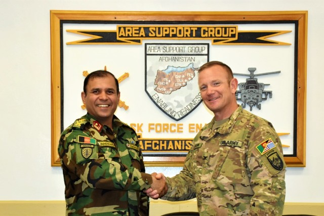 Area Support Group-Afghanistan (ASG-A) Commander Col. Jacob Peterson (right) hosted an Aug. 28 lunch meeting for (left) Afghan Col. Hamidullah Kahamani, the garrison support commander at Parwan Prison. As the ASG-A commander, Peterson provides base life support to many of the thousands of men and women who are assigned to Afghanistan in support of Resolute Support, a NATO-led mission to train, advise and assist the Afghan security forces and institutions. The Resolute Support Mission currently comprises around 16,000 personnel from 41 NATO Allies and partners.