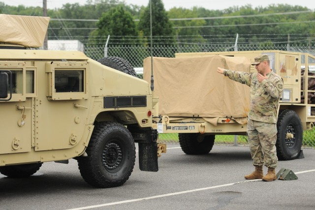 Sgt. 1st Class Lawrence Smashey, from Monroeville, NJ, provides direction to a Humvee driver as Soldiers from the 20th Chemical, Biological, Radiological, Nuclear, Explosives (CBRNE) Command, Aberdeen Proving Ground, Md.,  prepared to respond to the devastation from Hurricane Florence Sept. 14, 2018. Smashy is attached to the 20th CBRNE Command and works as the secretary to the general's staff. The Soldiers' actions are in line with the command's readiness initiative, and although they have not received any official request for assistance they will be prepared and ready to go if or when that request comes.