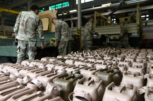 Soldiers from the Headquarters and Headquarters Company, 20th Chemical, Biological, Radiological, Nuclear, Explosives (CBRNE) Command, Aberdeen Proving Ground, Md., assemble fuel canisters to be used in case they are asked to provide disaster relief to citizens in the Carolinas and Virginia who were hit by Hurricane Florence Sept. 14, 2018. The Soldiers' actions are in line with the command's readiness initiative, and although they have not received any official request for assistance they will be prepared and ready to go if or when that request comes.