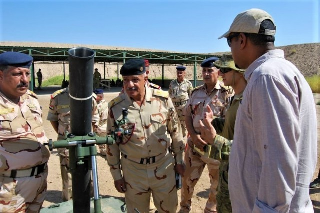 "U.S. Cavalry troopers from 1st Squadron, 3rd Cavalry Regiment ""Brave Rifles,"" and Australian instructors show an Iraqi brigadier general the new M120 mortar system, Sep. 5, 2018. The Brave Rifles are currently deployed to Iraq in support of Operation Inherent Resolve, working by, with and through the Iraqi Security Forces and coalition partners from 74 nations to defeat ISIS in areas of Iraq and Syria, and to set conditions for follow-on operations to increase regional stability."
