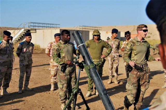 "U.S. Cavalry troopers from 1st Squadron, 3rd Cavalry Regiment ""Brave Rifles,"" and Australian instructors show Iraqi mortarmen the new M120 mortar system, Sep. 5, 2018. The Brave Rifles are currently deployed to Iraq in support of Operation Inherent Resolve, working by, with and through the Iraqi Security Forces and coalition partners from 74 nations to defeat ISIS in areas of Iraq and Syria, and to set conditions for follow-on operations to increase regional stability."
