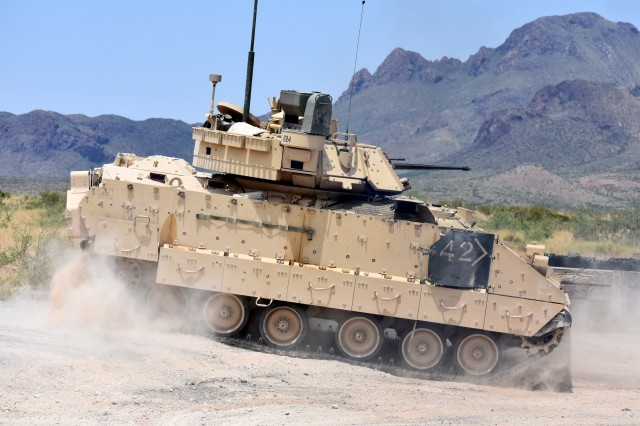 An M2A3 Bradley Fighting Vehicle crew changes position on the range during gunnery training at the Doña Ana Range Complex, N.M., Aug. 3, 2018. The Army is developing a new Next Generation Combat Vehicle as part of a concerted modernization strategy.