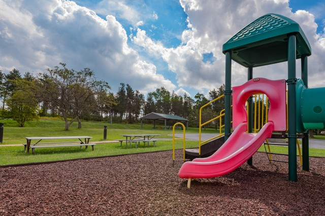 Family housing boasts a paved walking trail, picnic area, landscaping, lighted sidewalks, and playgrounds.