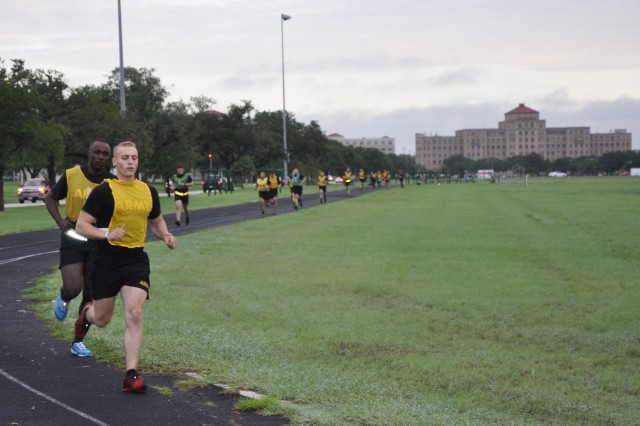 Sgt. Jake Weingartz leads his heat of runners in the two-mile run during the Army Combat Fitness Test Sept. 17, 2018, on Fort Sam Houston, Texas. The ACFT is the first portion of the Army Best Medic Competition. Twenty-seven teams of two Soldier-medics are competing in this year's Best Medic Competition. (U.S. Army photo by Courtney Dock)