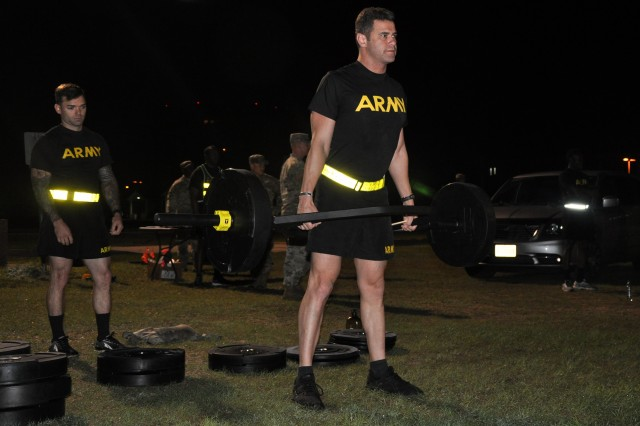 Capt. Michael Broussard practices a deadlift before beginning the Army Combat Fitness Test Sept. 17, 2018 on Fort Sam Houston, Texas. The ACFT is the first portion of the Army Best Medic Competition. Twenty-seven teams of two Soldier-medics are competing in this year's Best Medic Competition. (U.S. Army photo by Courtney Dock)