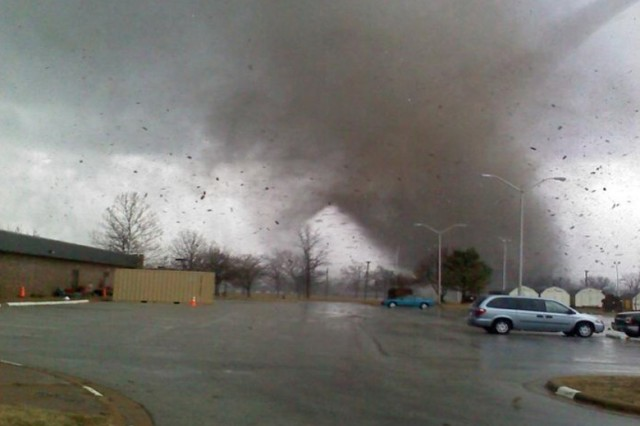 In this Army file photo from Dec. 31, 2010, a tornado touches down at Fort Leonard Wood, Missouri. (U.S. Army photo by Catherine Threat, 88th Regional Support Command)