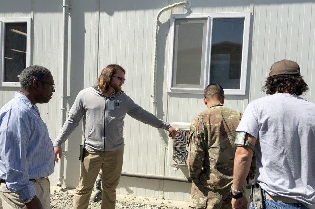 (Second from left) Andrew Brand is an electrical engineer and the on-site program manager of the congressionally mandated Task Force POWER (Protect Our Warfighters and Electrical Resources), headquartered at Bagram Air Field. Fifteen two-man teams of journeymen and master electricians inspect and repair electrical systems deficiencies all throughout Combined Joint Operations Area-Afghanistan.