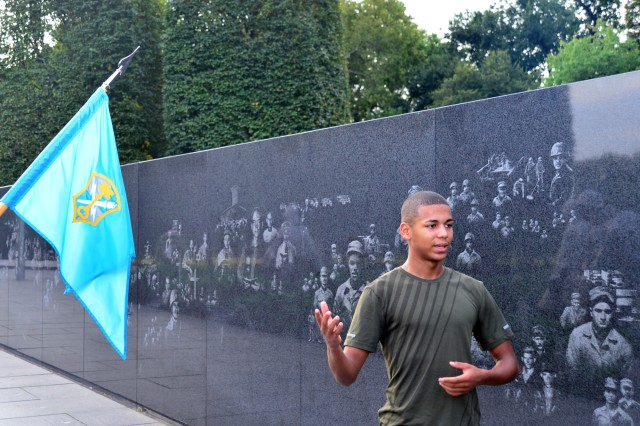 Pfc. Jayson Liriano, human resources clerk, Headquarters and Headquarters Company (HHC), U.S. Army Intelligence and Security Command (INSCOM), briefs personnel at the Korean War Memorial during the HHC INSCOM Capitol Run in Washington, D.C., Sept. 7.