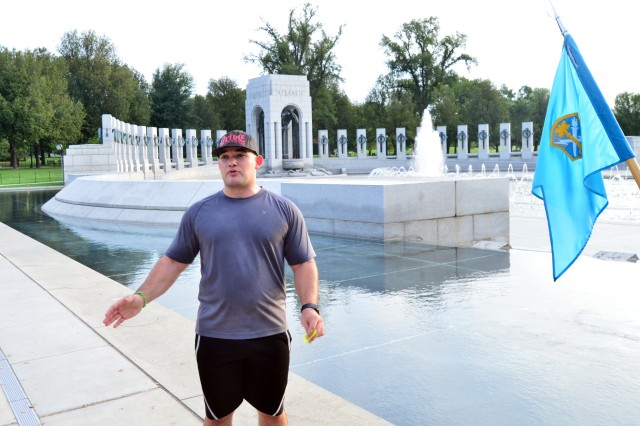 Spc. William Howard, systems maintainer, Headquarters and Headquarters Company (HHC), U.S. Army Intelligence and Security Command (INSCOM), briefs personnel at the World War II Memorial during the HHC INSCOM Capitol Run in Washington, D.C., Sept. 7.