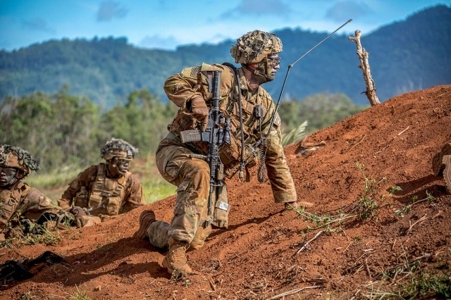A weapons squad leader with 2nd Infantry Brigade Combat Team, 25th Infantry Division, prepares to move his squad forward during a combined arms live-fire exercise at Schofield Barracks, Hawaii, Aug. 3, 2018. The exercise is part of an overall training progression in order to maintain combat readiness in preparation for a Joint Readiness Training Center rotation later this year.