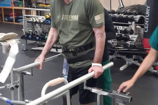 Iveri Buadze practices walking with a prosthetic leg at Walter Reed National Military Medical Center in July 2018.