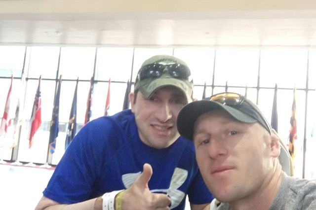 Iveri Buadze (left) spends time with his brother, Amiran, at Walter Reed National Military Medical Center in July 2018.