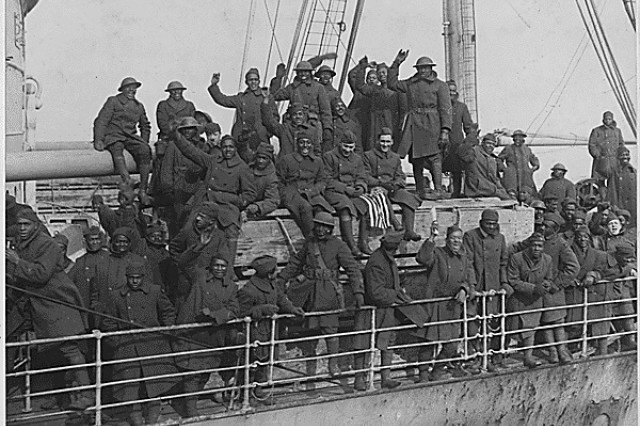 Soldiers of the New York Army National Guard's 369th Infantry Regiment arrive back in New York harbor on Feb. 12, 1919 after serving in France during World War I. The 369th was an African-American unit in a segregated Army which had served under French Army command but earned so many awards for heroism that they became known as the Harlem Hellfighters.