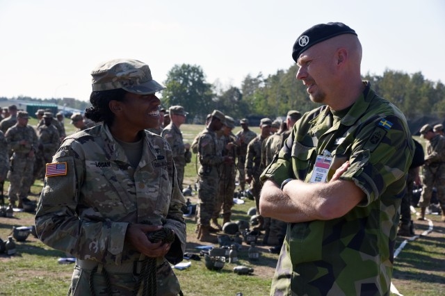 A Swedish representative from the Organization for Security and Cooperation in Europe (OSCE) talks with a U.S. Soldier participating in a U.S. Army Air Assault course at the Grafenwoehr Training Area, Germany, Sept. 18, 2018.  The OSCE is conducting a two-day treaty compliance visit to U.S. Army facilities in Grafenwoehr to fulfill provisions of the Vienna Document 2011.  The provisions require the U.S. Army to host a visit to a military facility in Europe once every five years and within one year of deployment of new weapon and equipment systems to Europe.  Representatives from 28 countries participated in this year's visit.