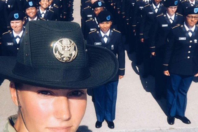 Drill Sergeant (SSG) Cori Noble, 95th Training Division, stands in front of a company of BCT graduates.