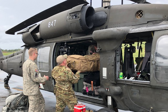 Indiana National Guard soldiers with the 2-238th General Support Aviation Battalion prepare a UH-60 for take-off at the Gary Aviation Facility and prep the aircraft for hurricane relief efforts on September 16, 2018.