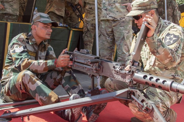 Spc. Kellin Kirby, a team leader with 1st Battalion, 23rd Infantry Regiment, instructs an Indian army soldier on the use of the M2 50 Cal. Machine Gun during a weapons demonstration Sept. 18, 2018, at Chaubattia Military Station, India. This was part of Yudh Abhyas, an exercise that enhances the joint capabilities of both the U.S. and Indian army through training and cultural exchange, and helps foster enduring partnerships in the Indo-Asia Pacific region. (U.S. Army photo by Staff Sgt. Samuel Northrup, 1-2 Stryker Brigade Combat Team)