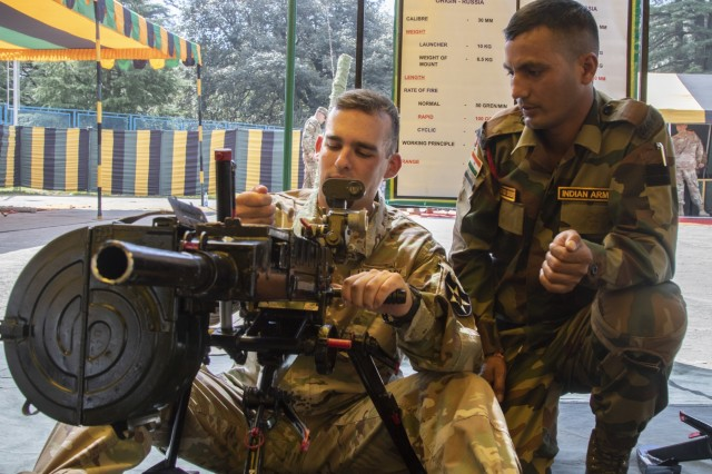 1st Lt. James Farley, a Soldier with 1st Battalion, 23rd Infantry Regiment, receives instruction from an Indian army soldier on the use of the 30 mm Automatic Grenade System during a weapons demonstration Sept. 18, 2018, at Chaubattia Military Station, India. This was part of Yudh Abhyas, an exercise that enhances the joint capabilities of both the U.S. and Indian army through training and cultural exchange, and helps foster enduring partnerships in the Indo-Asia Pacific region. (U.S. Army photo by Staff Sgt. Samuel Northrup, 1-2 Stryker Brigade Combat Team)