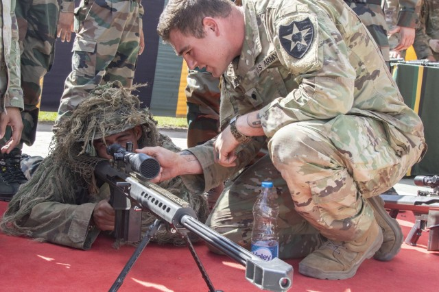 Spc. TJ Ashley, a Soldier with 1st Battalion, 23rd Infantry Regiment, instructs an Indian army Soldier on the use of the M107 Sniper Rifle during a weapons demonstration Sept. 18, 2018, at Chaubattia Military Station, India. This was part of Yudh Abhyas, an exercise that enhances the joint capabilities of both the U.S. and Indian army through training and cultural exchange, and helps foster enduring partnerships in the Indo-Asia Pacific region. (U.S. Army photo by Staff Sgt. Samuel Northrup, 1-2 Stryker Brigade Combat Team)
