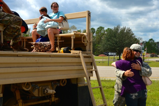 North Carolina Army National Guard Soldiers evavuate residents affected by Hurricane Florence