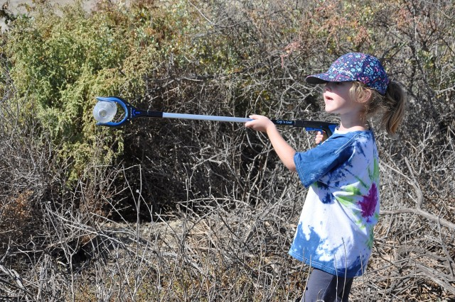 Amelia Jones, 4, picks up a plastic bottle out of the Santa Ana River Marsh during California's Coastal Cleanup Day Sept. 15 near Newport Beach, California. Amelia is the daughter of Erin Jones, a biologist with the U.S. Army Corps of Engineers Los Angeles District, and Chris Jones, who also is a biologist.