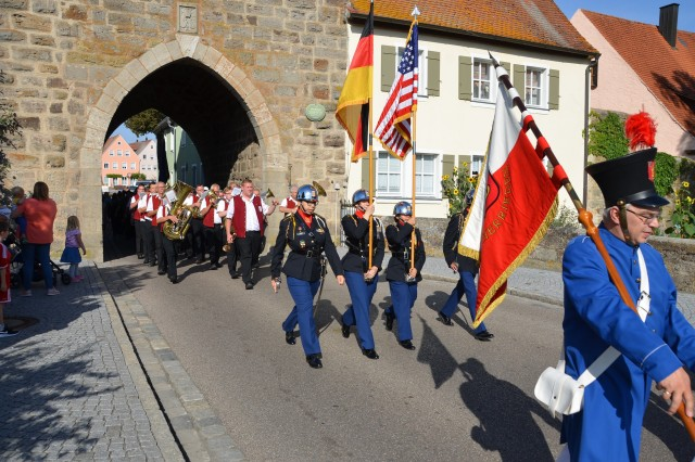 The Ansbach High School JROTC Color Guard leads the way for the parade during the recent partnership celebration of USAG Ansbach and Herrieden Sept. 17, 2018.
