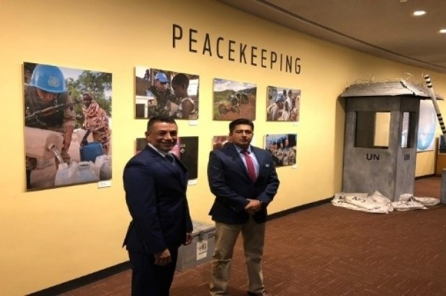 Mexican Army (SEDENA) Majors José Badillo and Carlos Hernandez view displays of UN Peacekeeping activities during their visit to UN headquarters as part of WHINSEC's UN Staff and Peacekeeping Operations class trip to New York in June. (U.S. Army photo by Maj. Christa Mingo, WHINSEC instructor)
