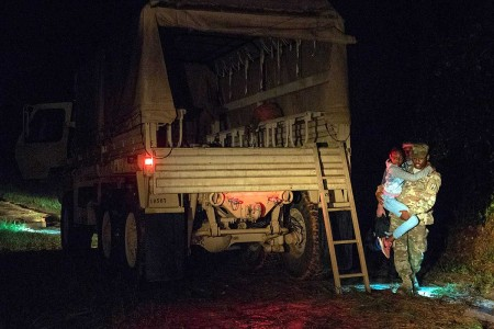 South Carolina Army National Guard Soldiers with the 1053rd Transportation Company assist a family that was trapped inside their vehicle during the early morning hours as a result of flood waters on the roadway in Hamer, S.C., Sept. 18, 2018.  Approximately 3,090 Soldiers and Airmen are mobilized to respond and participate in recovery efforts in the communities as Tropical Storm Florence has caused flooding and damage to the state.