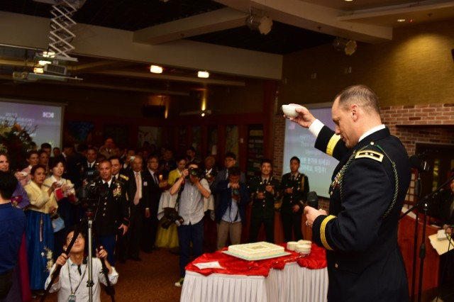 CAMP RED CLOUD, Republic of Korea -- Maj. Gen. D. Scott McKean, San Jose, California native and commanding general, 2nd Infantry Division/ROK-U.S. Combined Division, proposes a toast to guests during the Chuseok Reception at Mitchell's Grill Sept. 20. The 2ID/RUCD hosted its final Camp Red Cloud Chuseok Reception to reminisce the enduring ROK-U.S. partnership and celebrate traditional Korean customs with members of the local community