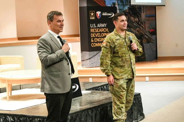 Mr. Stephan Boehmsdorff, Germany foreign liaison officer and Lt. Col. Hamish John Ashman, Australia foreign liaison officer, take questions about the RDECOM international program.