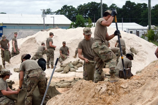 Fort Jackson Soldiers and trainees load sand bags in preparation for Hurricane Florence.
