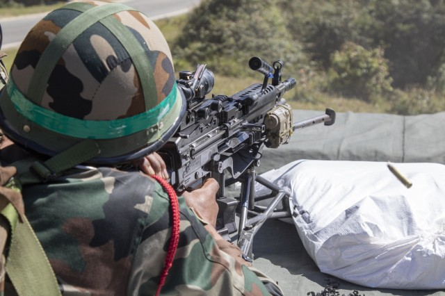 A soldier with 99th Mountain Brigade fires a M249 Squad Automatic Weapon Sept. 19, 2018, at Chaubattia Military Station, India. This was part of Yudh Abhyas, an exercise that enhances the joint capabilities of both the U.S. and Indian army through training and cultural exchange, and helps foster enduring partnerships in the Indo-Asia Pacific region. (U.S. Army photo by Staff Sgt. Samuel Northrup)