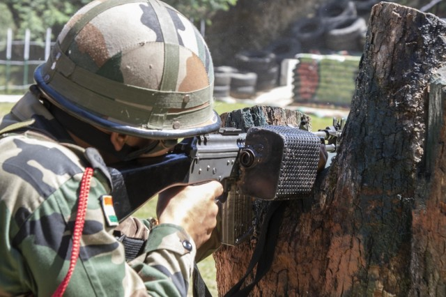 A soldier with 99th Mountain Brigade, fires his INSAS Rifle at a reflex range Sept. 19, 2018, at Chaubattia Military Station, India. This was part of Yudh Abhyas, an exercise that enhances the joint capabilities of both the U.S. and Indian army through training and cultural exchange, and helps foster enduring partnerships in the Indo-Asia Pacific region. (U.S. Army photo by Staff Sgt. Samuel Northrup)
