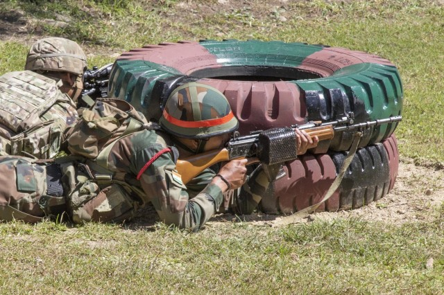 A soldier with 99th Mountain Brigade, fires his INSAS Rifle at a reflex range with his U.S. counterpart from the 1st Battalion, 23rd Infantry Regiment, Sept. 19, 2018, at Chaubattia Military Station, India. This was part of Yudh Abhyas, an exercise that enhances the joint capabilities of both the U.S. and Indian army through training and cultural exchange, and helps foster enduring partnerships in the Indo-Asia Pacific region. (U.S. Army photo by Staff Sgt. Samuel Northrup)