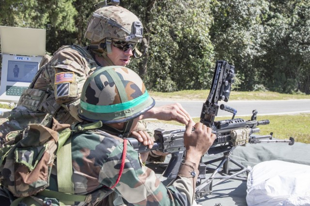 A Soldier with 1st Battalion, 23rd Infantry Regiment, instructs his Indian counterpart from the 99th Mountain Brigade on how to clear a M249 Squad Automatic Weapon Sept. 19, 2018, at Chaubattia Military Station, India. This was part of Yudh Abhyas, an exercise that enhances the joint capabilities of both the U.S. and Indian army through training and cultural exchange, and helps foster enduring partnerships in the Indo-Asia Pacific region. (U.S. Army photo by Staff Sgt. Samuel Northrup)