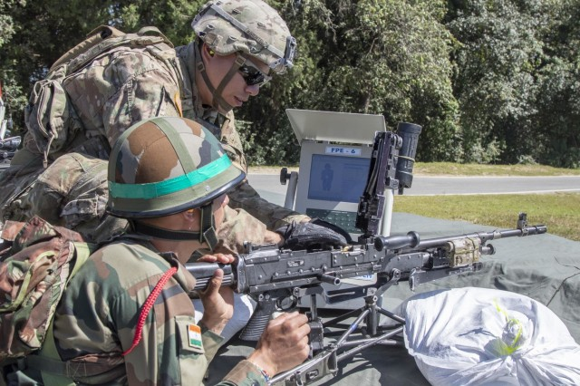 A Soldier with 1st Battalion, 23rd Infantry Regiment, instructs his Indian counterpart from the 99th Mountain Brigade on how to clear a M240 Machine Gun Sept. 19, 2018, at Chaubattia Military Station, India. This was part of Yudh Abhyas, an exercise that enhances the joint capabilities of both the U.S. and Indian army through training and cultural exchange, and helps foster enduring partnerships in the Indo-Asia Pacific region. (U.S. Army photo by Staff Sgt. Samuel Northrup)