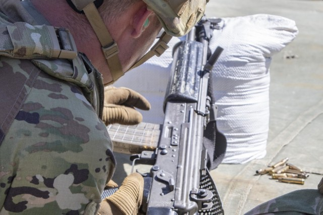 A Soldier with 1st Battalion, 23rd Infantry Regiment, loads a magazine into an INSAS Rifle Sept. 19, 2018, at Chaubattia Military Station, India. This was part of Yudh Abhyas, an exercise that enhances the joint capabilities of both the U.S. and Indian army through training and cultural exchange, and helps foster enduring partnerships in the Indo-Asia Pacific region. (U.S. Army photo by Staff Sgt. Samuel Northrup)