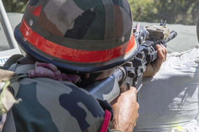 An Indian army soldier with 99th Mountain Brigade fires an M4 Rifle Sept. 19, 2018, at Chaubattia Military Station, India. This was part of Yudh Abhyas, an exercise that enhances the joint capabilities of both the U.S. and Indian army through training and cultural exchange, and helps foster enduring partnerships in the Indo-Asia Pacific region. (U.S. Army photo by Staff Sgt. Samuel Northrup)
