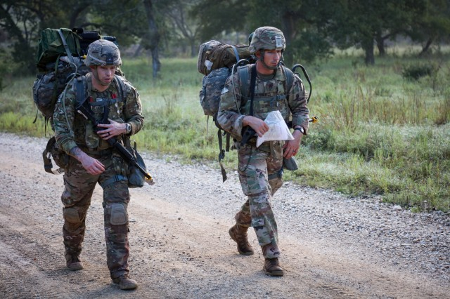 Staff Sgt. Cory Glasgow and Staff Sgt. Branden Mettura, 1st Armor Division, ruck through the terrain during the land navigation course of the 2018 Army Best Medic Competition, Sept. 18, 2018. Glasgow and Mettura won this year's competition.