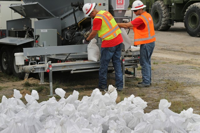 Emergency Operations Manager George Minges (right) and Emergency Operations Planner Andrew Fleming, both from the Louisville District, U.S. Army Corps of Engineers, operate an hydraulic sandbag filler in Horry County, S.C., in support of Hurricane Florence flood risk management efforts underway across the region here, Sept. 17, 2018. The sandbagging system can generally fill up to 500 sandbags per hour and greatly enhances USACE's ability to provide sandbags during natural disasters. Since arriving in S.C., the team has worked with the local Army National Guard units to fill more than 5,500 sandbags. When disasters occur, USACE teams and other resources are mobilized from across the country to assist FEMA, state and county efforts regarding flood response. (U.S. Army photo by Edward N. Johnson)