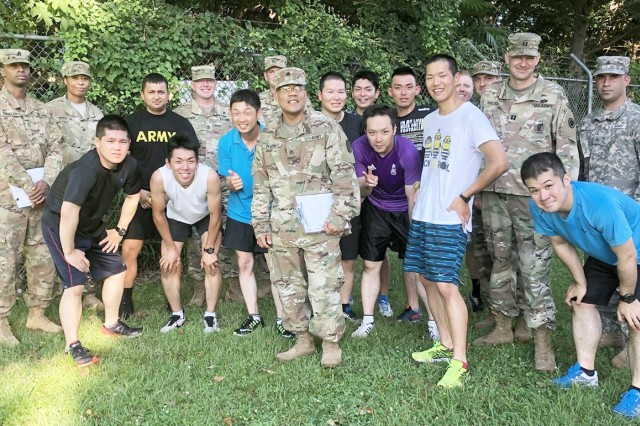 Participants in the most recent 10-week cooperative program between the U.S. Army and Japan Ground Self-Defense Force, which concluded in September at Camp Zama, pose for a photo after conducting an initial Army Physical Fitness Test.