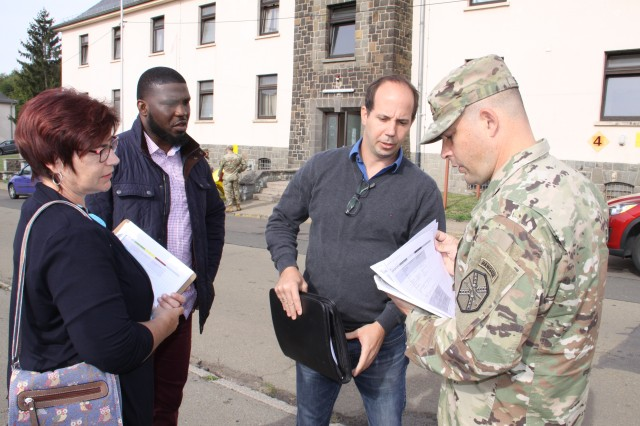 (Right) Col. Jason T. Edwards, U.S. Army Garrison Rheinland-Pfalz commander, discusses Installation Status Report-Infrastructure criteria with Mathias Reh, Victor Aruwah and Silke Drumm, Directorate of Public Works specialists at Baumholder. The commander received a firsthand look of how ISR-I inspectors assess facility conditions for future funding.