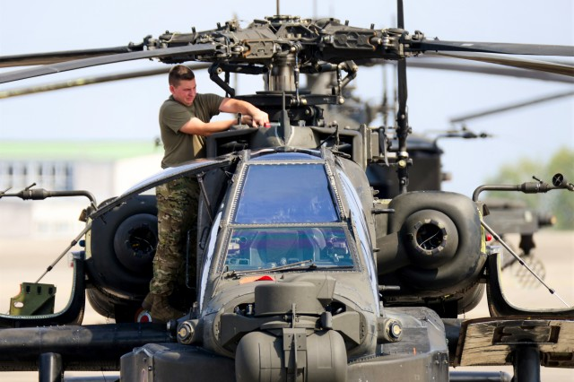 A U.S. Soldier with D Company, 1st Battalion, 3rd Aviation Regiment (Attack Reconnaissance), 12th Combat Aviation Brigade, conducts routine maintenance on a AH-64 Apache helicopter on Aug. 29, 2018, at Katterbach Army Airfield in Ansbach, Germany. The Army continues to identify ways that existing technology could be employed or re-combined to produce better products at lower cost.