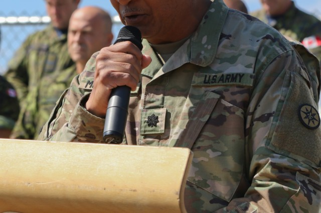 U.S. Army Lt. Col. Henry McCaskill leads U.S., Canadian and Romanian service members, local civic leaders and civilians in a prayer during the change of command ceremony at the Mihail Kogalniceanu Air Base in Romania, Sept. 17, 2018. U.S. Army Col. Wesley Murray assumed command of the Black Sea Area Support Team in place of U.S. Army Col. James McGlaughn. (U.S. Army National Guard photo by Spc. Hannah Tarkelly, 382nd Public Affairs Detachment/ 1st ABCT, 1st CD/Released)