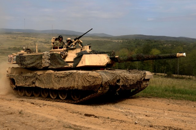 An M1 Abrams tank maneuvers through the Lest Military Training Area during a combined live fire exercise in Support of Operation Slovak Shield in Lest, Slovakia, September 17, 2018.The live-fire exercise includes the U.S. Army and the Slovakian Army working together to enhance our NATO relations and improve their skills while in a tactical environment. (U.S. Army photo by Pfc. Christina Westfall)