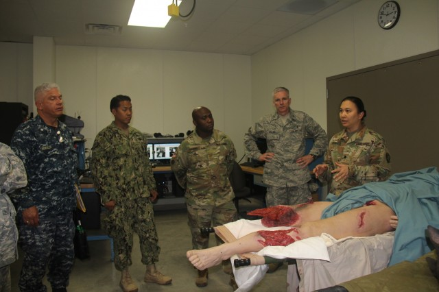 Lt. Col. Nonette Gegantoca (right), deputy site director for Regional Training Site (RTS)-Medical, shows distinguished visitors some of the equipment at the site Aug. 20, 2018, at Fort McCoy, Wis. RTS-Medical supported both unit and collective training during Global Medic, which coincided with Combat Support Training Exercise 86-18-02. (U.S. Army photo by Aimee Malone, Public Affairs Office, Fort McCoy, Wis.)