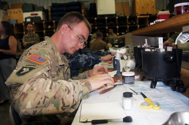 A Soldier works on creating prosthetic makeup to be used in moulage Aug. 20, 2018, at Regional Training Site (RTS)-Medical at Fort McCoy, Wis. RTS-Medical supported both unit and collective training during Global Medic, which coincided with Combat Support Training Exercise 86-18-02. (U.S. Army photo by Aimee Malone, Public Affairs Office, Fort McCoy, Wis.)