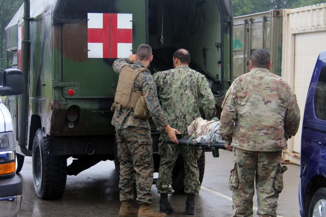 Service members load mannequins into an ambulance to be taken out to the field during Global Medic on Aug. 20, 2018, at Regional Training Site (RTS)-Medical at Fort McCoy, Wis. RTS-Medical supported both unit and collective training during Global Medic, which coincided with Combat Support Training Exercise 86-18-02. (U.S. Army photo by Aimee Malone, Public Affairs Office, Fort McCoy, Wis.)